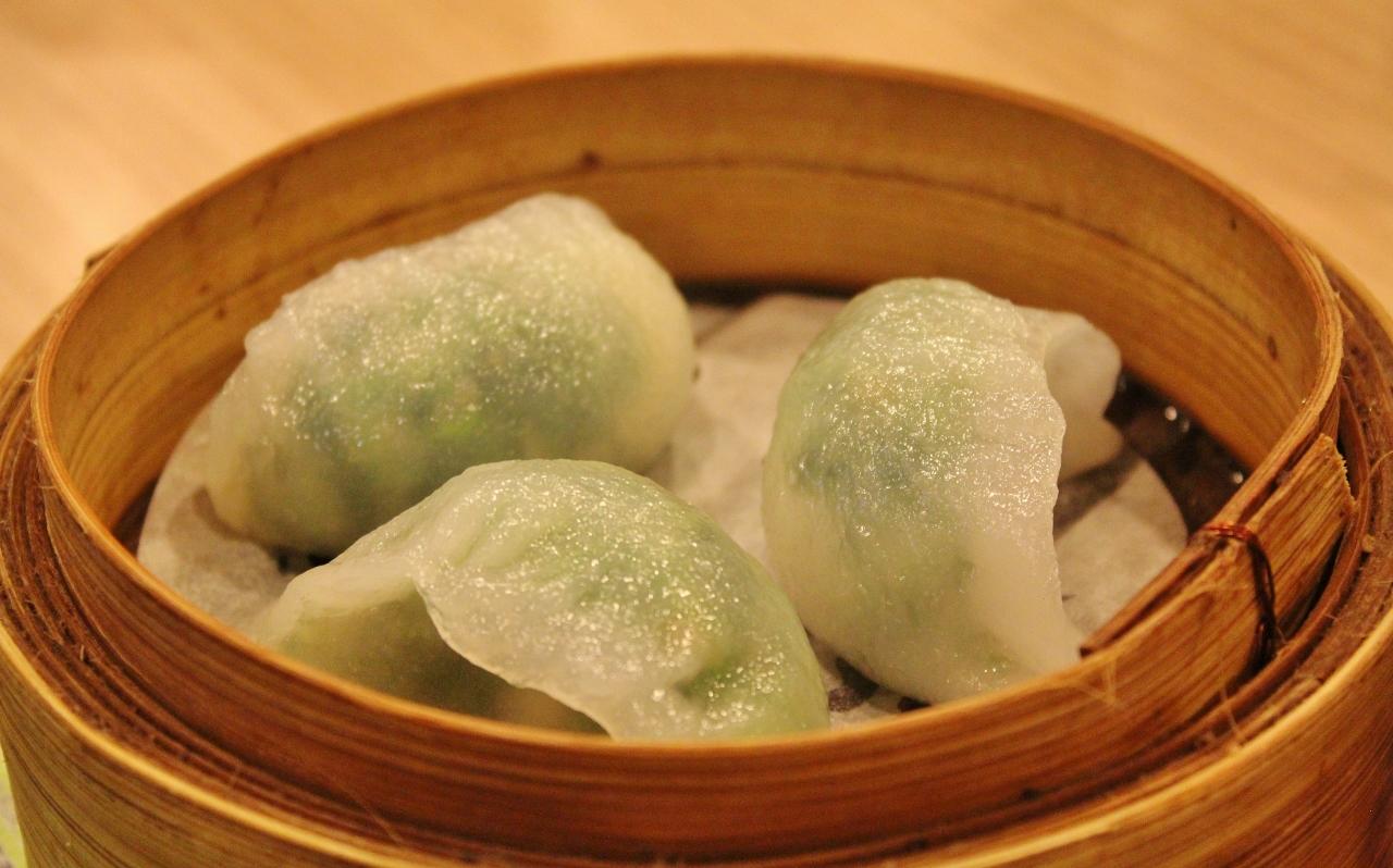 Steamed water cress dumpling filled with shrimp